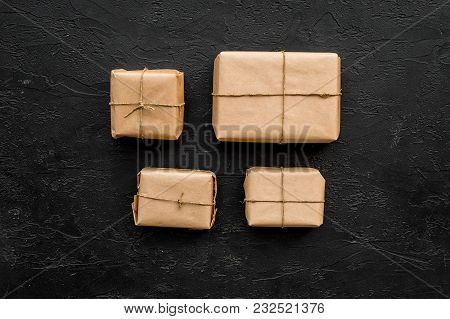 Parcels Box In Delivery Service Office On Black Background Top View Space For Text