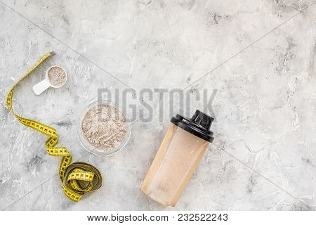 Nutrition For Workout With Protein Cocktail, Powder And Bars On Stone Table Background Top View Mock
