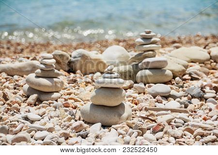 Stack Of Stones On The Sea Summer Beach.the Pile Of The Pebbles On The Stony Coast.stones Pyramid On