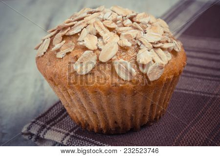 Vintage Photo, Fresh Muffin With Oatmeal Baked With Wholemeal Flour On Checkered Tablecloth