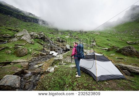 Female Hiker With A Backpack Standing Near Her Tent In The Mountains Copyspace Relax Resting Camping