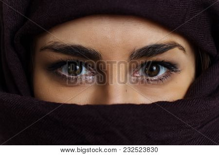 Close Up Female Brown Eyes Woman Portrait With Brown Cloth  Covered Her Face