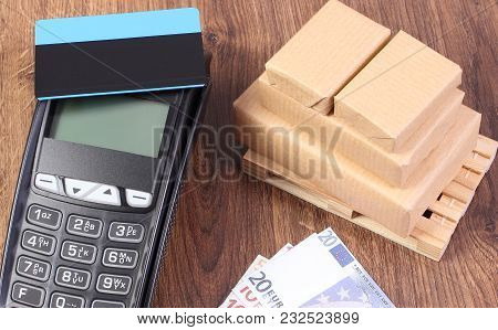 Payment Terminal With Contactless Credit Card, Currencies Euro And Small Wrapped Boxes On Pallet, Pa