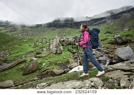 Young Woman Hiker Enjoying The Views While Hiking With Her Backpack In The Mountains Copyspace Campi