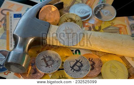 Bitcoin mining or mine for bitcoin, compared to the traditional idea of physical mining with a pickaxe