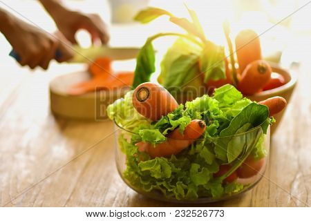 Fresh Vegetables In Glass Jar I Was On A Kitchen Table With Orange Light. Cooking Ideas