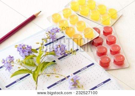 Cough Sore Throat Pastille With Notebook Calendar Planner On Background White