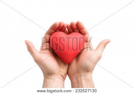 Red heart in man's hands. Health insurance or love concept