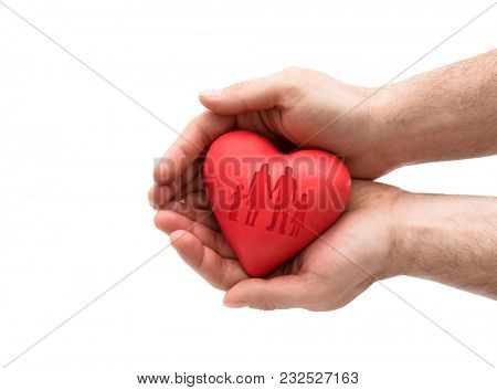 Red heart with imprinted family shape in man's hands.