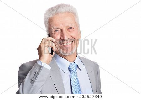 Portrait Of  Thoughtful Senior Man With Smartphone Isolated On White Background