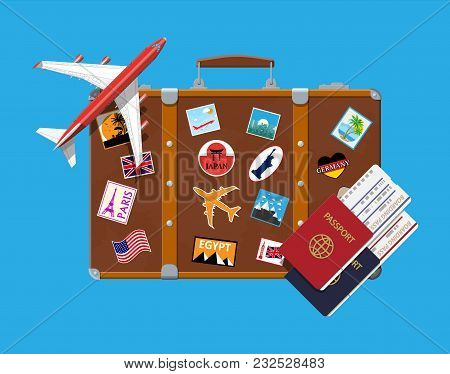 Travel Suitcase With Stickers Of Countrys And Citys All Over The World. Airplane. Passport And Board