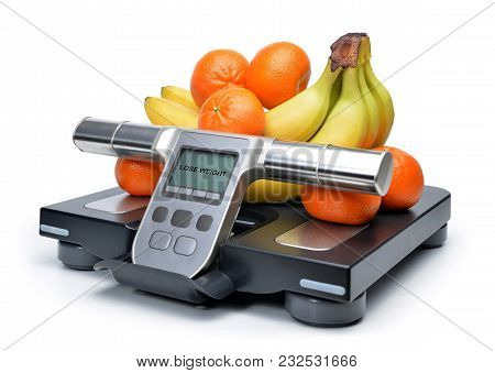 Scale With Fresh Fruits Isolated On A White Background. Lose Weight Concept. Healthy Lifestyle.