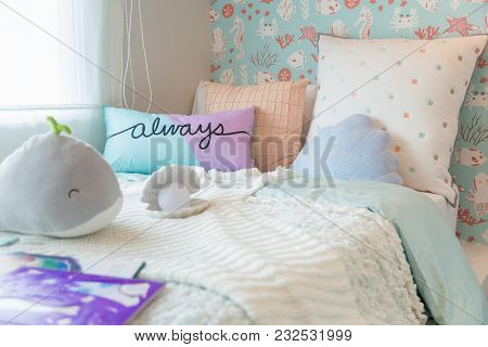 A Beautiful Bedroom Kids With A Sweet Pillows A Whale Doll And White Blanket With Warm Light Frome B