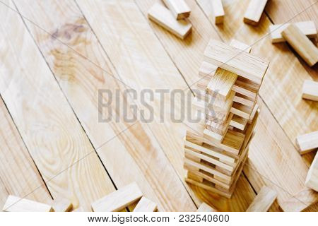 Wooden Building Blocks Tower On Wood Background With Copy Space. Wood Blocks Stack Game Background C