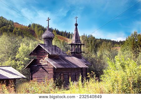 Wooden Church At The Foot Of The Hill. Vintage Wooden Log Church. Wooden Christian Timbered Church.