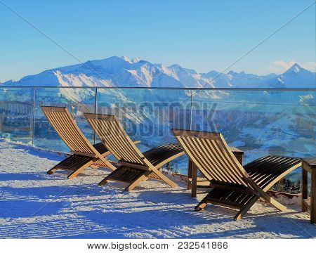 Zell Am See, Austria - February 14, 2018: Lounging In The Alps. Lounge Chairs To Enjoy The Alpine Vi
