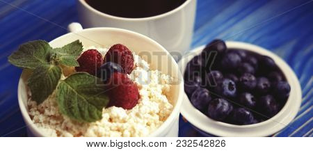 Russian cottage cheese with berry and mint, blueberries and coffee. Great breakfast.