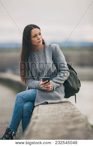 Young Lonely And Depressed Woman Is Sitting In Grief.
