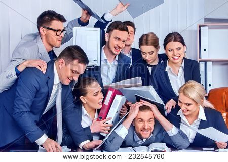 Business people office. Team people are unhappy with their leader. Intern man manager does not cope with his duties. Crowd in stress throw up their chief's papers. Employees scoff at boss.