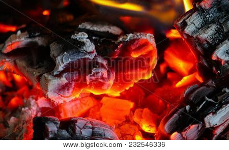 Bright Colorful Flame, Burning Wood At The Fireplace. Firewood Brick At The Fire, Closeup.