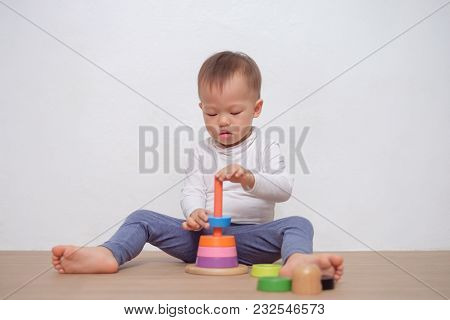 Cute Little Asian 18 Months / 1 Year Old Toddler Baby Boy Child Play With Colorful Wooden Pyramid To