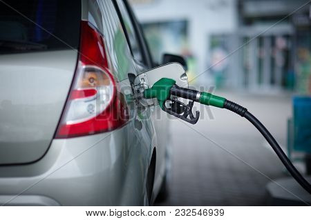 Car Refueling On A Petrol Station. Rear View.