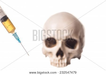 Blurry Skull And Syringe With Liquid Substans, Isolated On Whte Background
