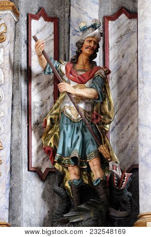 POKUPSKO, CROATIA - NOVEMBER 24: Statue of Saint George on the main altar in the Church of Assumption of the Virgin Mary in Pokupsko, Croatia, on November 24, 2016.