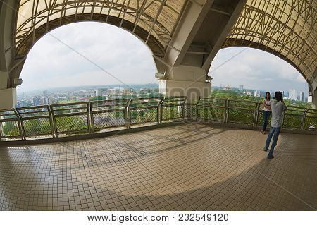 Kuching, Malaysia - August 26, 2009: Unidentified Couple Take Photo From The Tv Tower Viewpoint In K