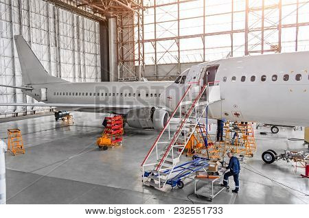 Aircraft During Repair, Technical Inspection Is A Working Technician. View Of Nose, A Cockpit With A