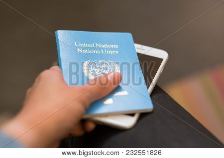 Bangkok, Thailand - March 7, 2018: A Hand Holds United Nations Passport And Iphone. Focus On The Uni