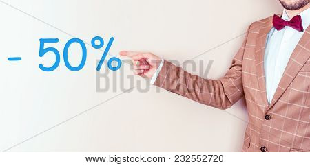 Man Pointing At Fifty Percent Discount Sign