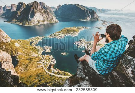 Man Traveler Taking Aerial Photo By Smartphone Sitting On Cliff Travel Lifestyle Concept Adventure O