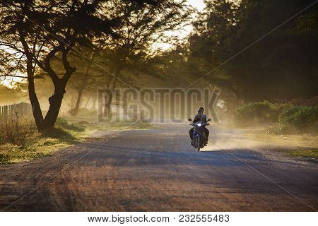 Rayong Thailand - Nov 8,2014 : Villager Riding Motorcycle On Beautiful  Dusty Road ,motorcycle In Mo
