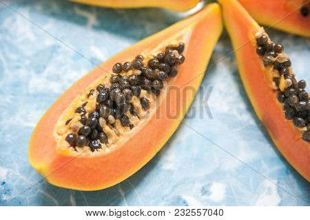 Juicy Slices Of Ripe Papaya On A Blue Background. Exotic Fruits, Healthy Food.
