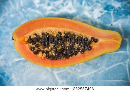 Cut Slices Of Papaya With Seeds. Macro Mode