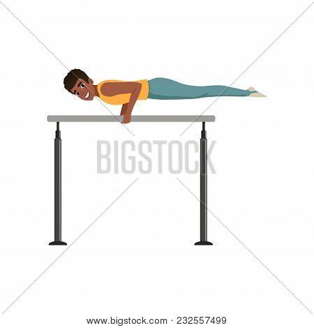 Professional Male Gymnast Training On Parallel Bars. Teen Boy In Sportswear. Artistic Gymnastics. Ol