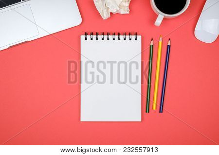 Modern Designer Office Desk Table With Blank Notebook Page, Laptop Computer And Cup Of Coffee. Top V