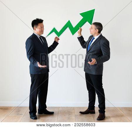 Businessmen with profit statictics icon