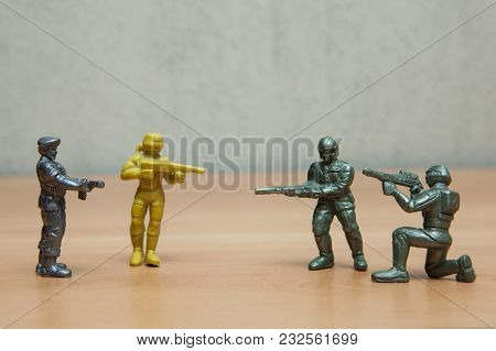 Soldiers Games Toys On A Wooden Floor.