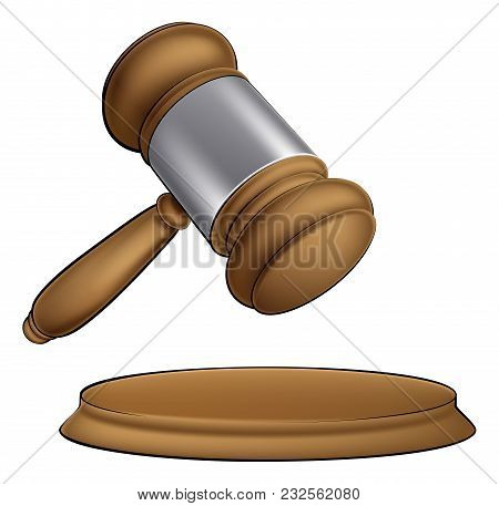 A Wooden Judge Court Or Auction Sale Gavel About To Bang Down