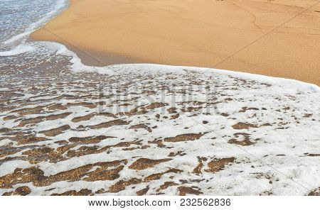 Background Of Soft Sea Wave On The Sandy Beach.