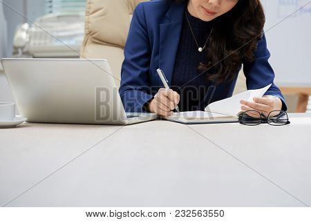 Close-up Shot Of Unrecognizable White Collar Worker Taking Notes While Working On Start-up Project A
