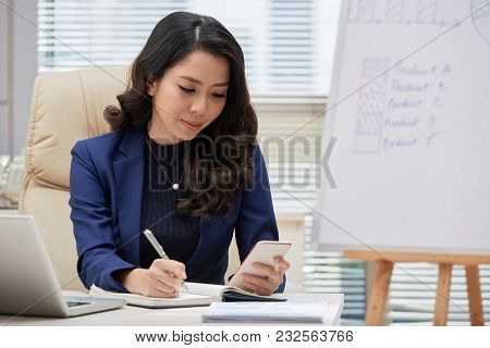 Attractive Young Manager In Formalwear Sitting At Office Desk And Distracted From Work In Order To T