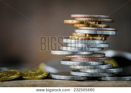 Closeup Strack Of Money Coins With Differrent Position Wording Bonus , Idea  For Money And Business