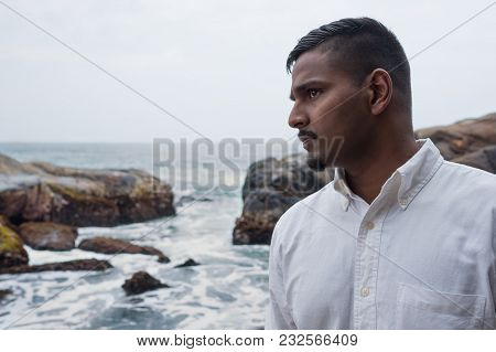 Smart And Handsome Asian Man Near The Sea Shore Looking Aside. He Is From Sri Lanka.