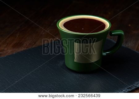 Green Porcelain Coffee Cup On Stone Board Over Wooden Background, Selective Focus, Close-up. Copy Sp