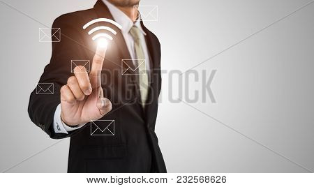 Businessman Touches Icon Wifi Of The Page Send Message Via Email With Copy Space