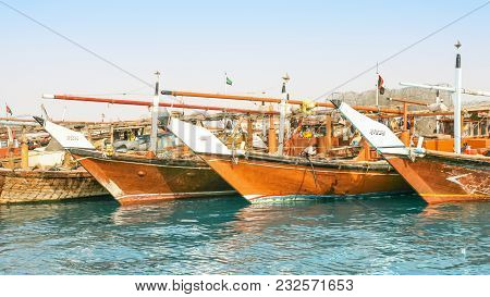 Abu Dhabi, Uae - March 27, 2005:  Traditional Wooden Fishing Dhows Berthed In The Dhow Harbour In Ab