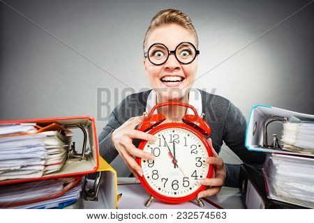 Paper Work Against Time. Young Expressive Woman In Office With Big Red Clock. Crazy Happy Businesswo